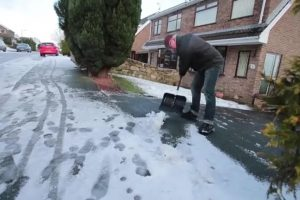 kingways winter tyres man shovelling snow from his driveway